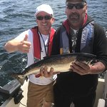 Dinner is served, salmon in hand, Active Angler Fishing Charters 1025 Lee Rd | French Creek Mari