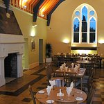 The dining room is a splendid Gothic hall,offering a good choice of freshly cooked food.