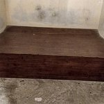 The only place for prisoners (up to 8 in a small cell) to sit and sleep.
