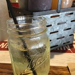 White Sangria with peach schnaps lacked fruit, but served in a cute Mason jar.