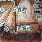 Dollar bills cover the walls