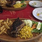 ribs,huge portions served on a board, very tasty
