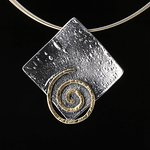Beautiful modern spiral neckless, made from 925 Silver oxydized and plated partial with 24k Gold