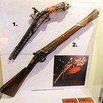 flintlock pistol and a blunderbuss
