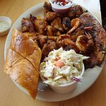 Seafood Platter, with potatoes (spicy), garlic bread and coleslaw