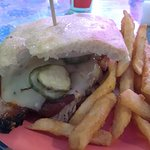 Texas A-- Beef Brisket Sandwich with cheese, pickles and BBQ sauce