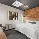 Reclaimed Boards make this King Room extra cozy