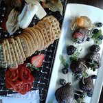 Cheese tray and chocolate covered strawberries