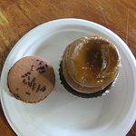 large chocolate macaroon and chocolate cupcake
