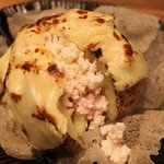 Grilled potato with tartar sauce and cheese