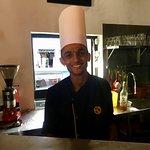 Warm Sri Lankan smile delivering great food.