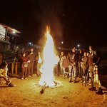 Travellers enjoying Bon Fire during winters at Kosi Valley Retreat