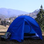 Camping in a valley setup opposite Kosi Valle Retreat