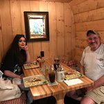 Grandpa and granddaughter enjoying dinner at a German restaurant in Leavenworth.