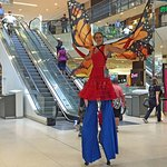 Stilt walkers roaming the mall