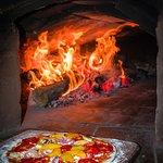 Ven y prueba nuestras deliciosas pizzas!