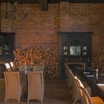 The beautiful historic dining room with two open fire places!
