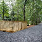 Treat yourself to a Deluxe RV site with a private deck and fenced area.
