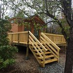 Feel like campground royalty in the Barley Tiny Home with a 15 by 16 foot deck and fenced play a