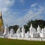 set of white chedis at Wat Suan Dok