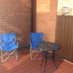 Outside seating area, own chairs in photo but chairs and table provided, nice and shaded and qui