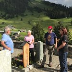 My family chatting with a distant relative at the St. Antonien protestant church and cemetery.