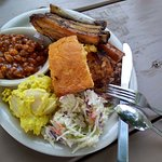 Pulled Pork, chicken, ribs and susage with cornbread, beans, potato salad and cole slaw