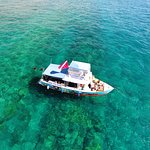 Boat at the coral reef with snorkelers and divers.