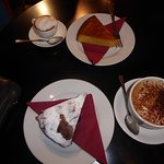 Cinnamon and orange cake, raspberry and chocolate brownie with coffees