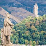 Robert the Bruce statue with the Wallace Monument in the distance