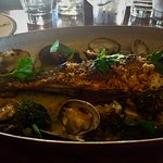 Branzino: a wonderful whole fish breaded and cooked in oil with clams on the side. The clams wer