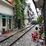 Train coming through the Hanoi old quarter.