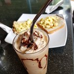Frappe with scrambled eggs and bread