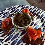 Salmon on brown bread with sea beans and spicy peppers