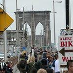 solid line of people walking on the bridge