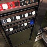 Elevator panel/ Blue tape on close button. Is it broken? Safe?