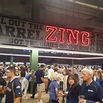 Happy baseball fans looking for food and drink