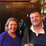 Enjoying a whiskey margarita in bar of Bushmills Distillery