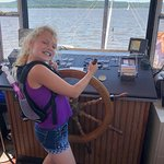 My daughter captain was kind and let her hold the wheel