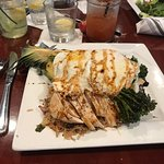 Pineapple stuffed with rice, asparagus and topped with eggs