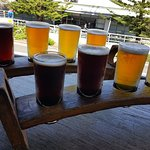 A generous rack of 5 on-tap craft brews @ $25 - great beers at a fair cost.