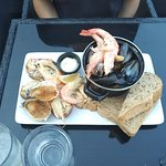 Hot and Cold seafood platter: Oysters Rockerfella, cravattes, steamed mussels, prawn, crab claws