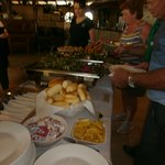 Salads and butter, bread rolls. All prepared for group.
