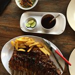 Big portion of pork ribs with fries