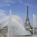 Fountains, rainbow and the Eiffel Tower