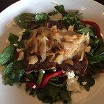 insalata daniella - salad with: steak, goat cheese, asparagus, red pepper, carmelized onions