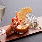 Creamy scampi soup with grana padano cheese chips