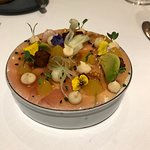 Salmon tartare with micro greens, florals and pureed root vegatables