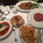 Steak tartare, duck with roasted potatoes, fish