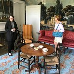 Guide explaining the wallpaper and carpet in the formal parlor.